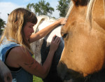 Rose De Dan offers Reiki to horses. Photo: Rhonda Hanley